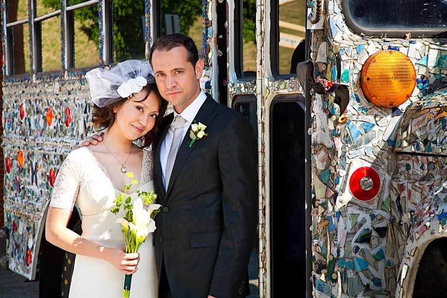 bride and groom in front of avam school bus