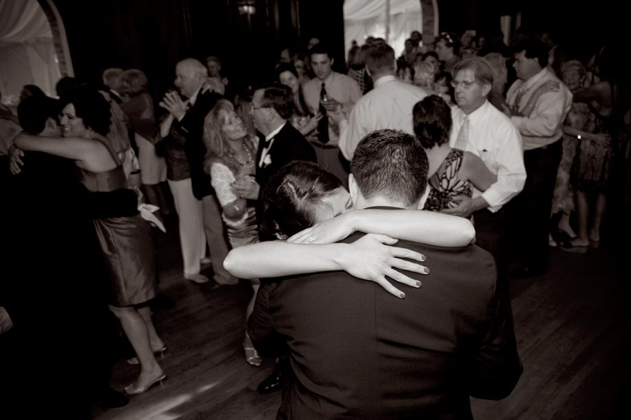 bride hugging groom while dancing