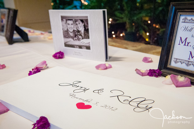 wedding sign in board with purple pink petals