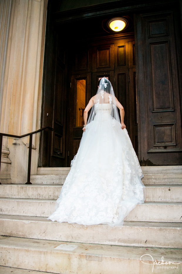 bride walking up the steps of the peabody