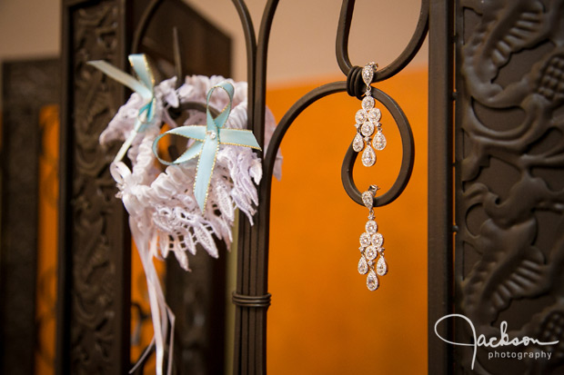 earrings and garter on iron railing