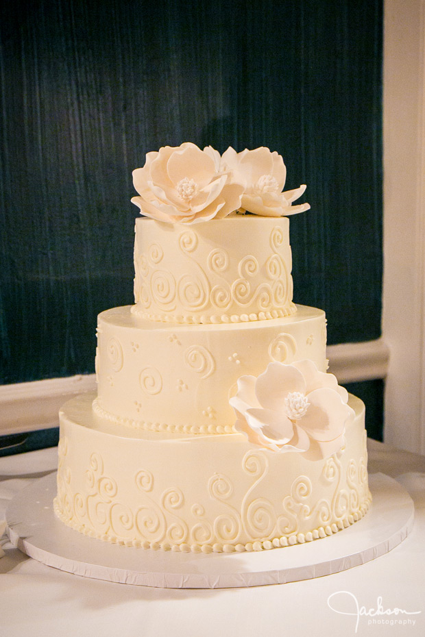 flowered tiered white wedding cake