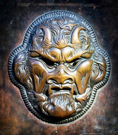 angry bronze devil