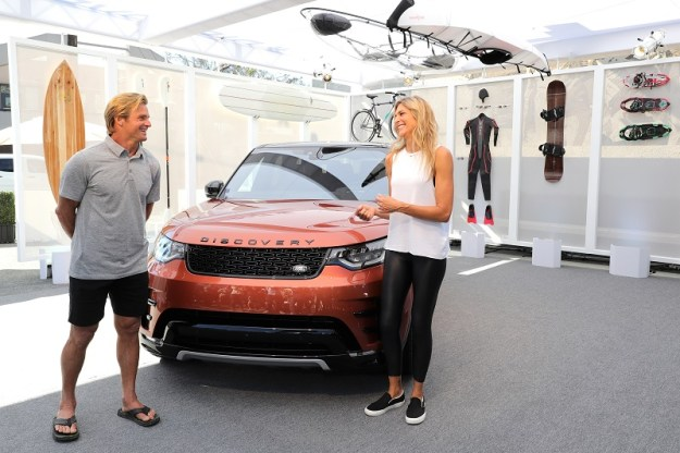 VENICE, CA - NOVEMBER 11: Big-wave surfer, Laird Hamilton, and champion volleyball player and fitness leader, Gabby Reece, with the all-new Land Rover Discovery SUV at the vehicle's North American debut in the iconic Venice neighborhood of Los Angeles on Abbot Kinney Boulevard on November 11, 2016 in Venice, California. (Photo by Neilson Barnard/Getty Images for Jaguar Land Rover)