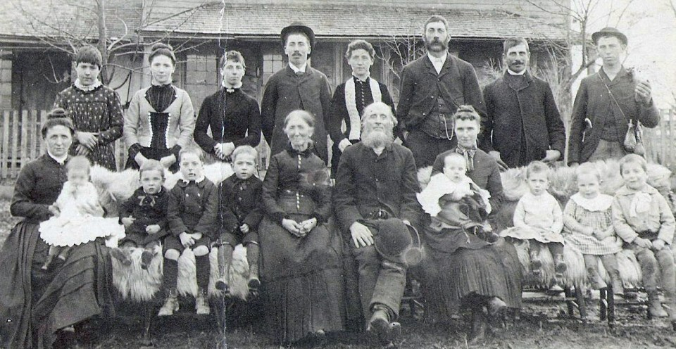 Solomon Beam Family circa 1886. Chris Climenhage is 3rd from the left at the back. In front from the left is Maggie (Beam) Climenhage holding Bert, Charlie, Ivora, and Levi.