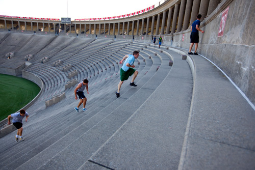 Harvard Students running the Stadium. Source.