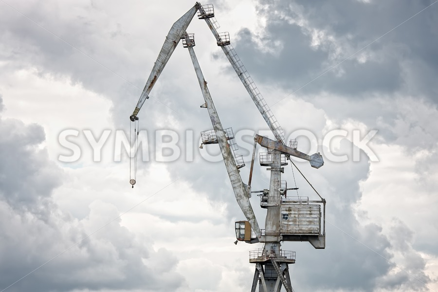 Giant old crane against dark sky - Jan Brons Stock Images