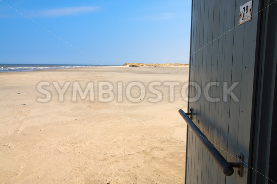 House with a view on sand dunes, beach and sea - Jan Brons Stock Images