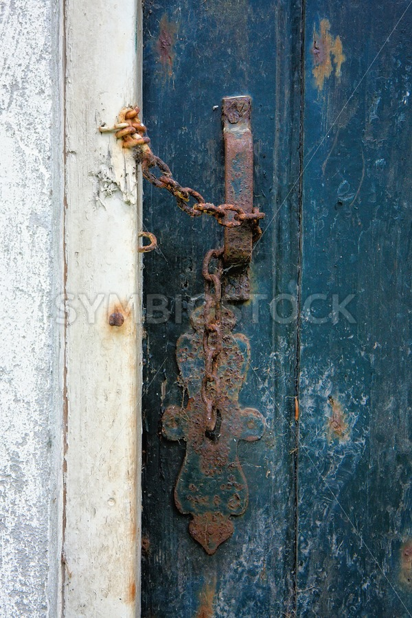 Old door entrance of ruined building. - Jan Brons Stock Images