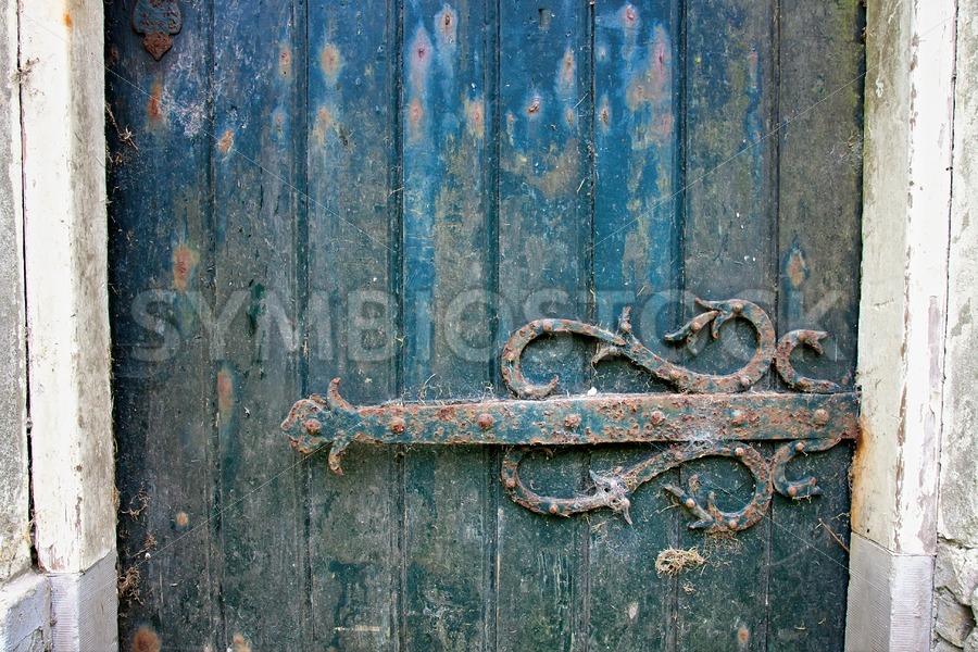 Old door hinge of ruined building