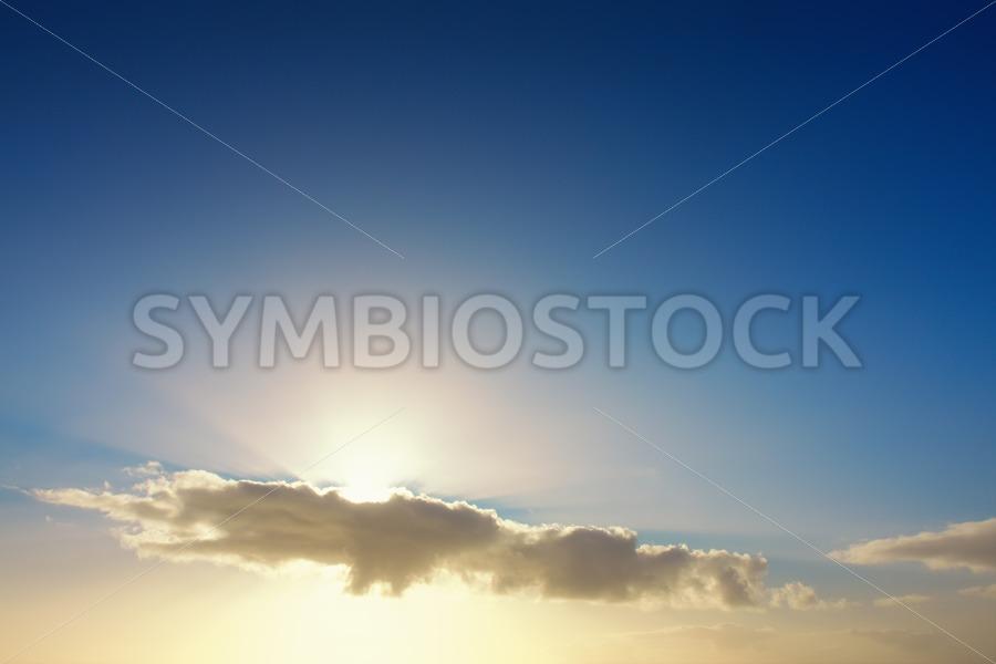 Sunbeams behind clouds