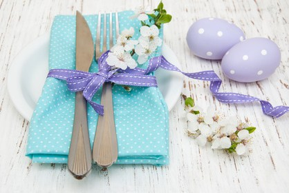 easter table setting with cherry blossoms  on a old wooden background