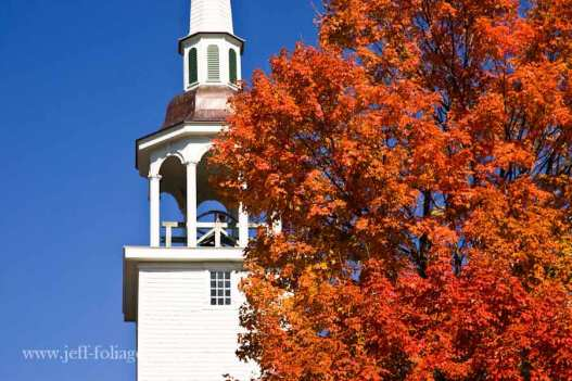 Brooklyn Connecticut church with orange fall foliage around Steeple