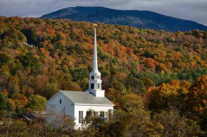 Early fall color in Stowe, A little white steepled church in the hills of Vermont.