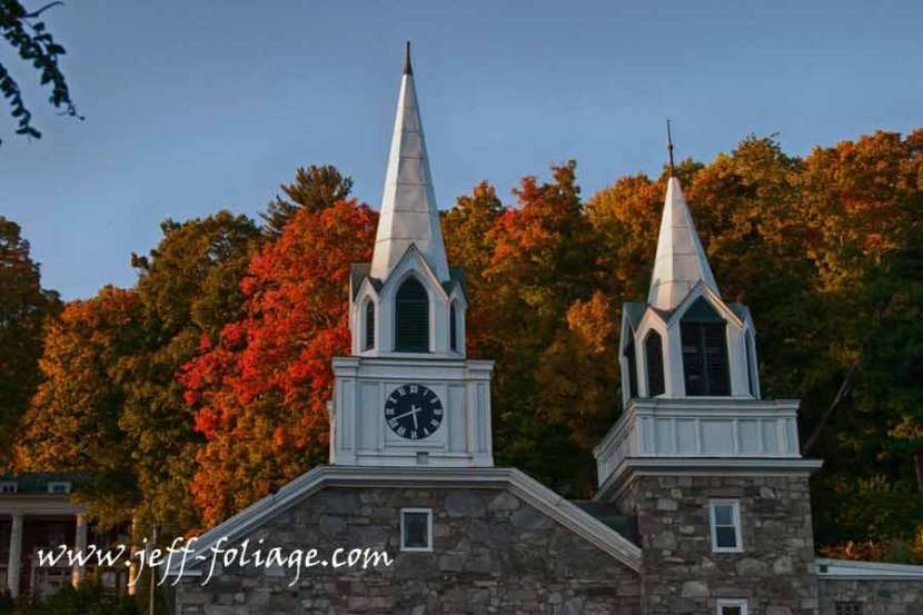 Fall colors behind the Springfield twin church steeples.