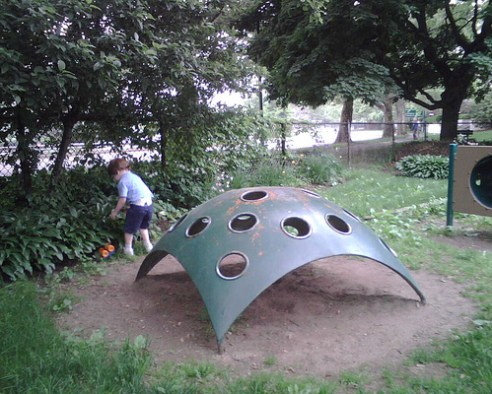 old playground equipment metal with holes that look like cheese