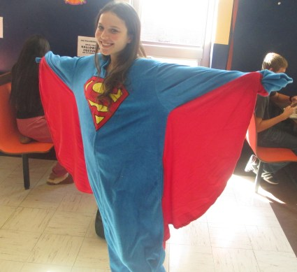 "Flying high, Sarah Tract, in her Superman onesie, wins the ""Most Likely to Soar Through the 'T'"" award. Sarah truly epitomizes our vision of a superhero."