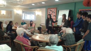 Project Care members often collaborate on poems with the residents, aiming to produce a complete book of poetry by the end of the school year.