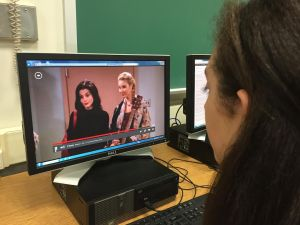 "Senior Maddie Kaufman watches ""Friends"" in school."