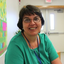 Science teacher Ms. Lesse has been working at Jericho for 30 years. Even though there are so many to choose from, two of her favorite memories at Jericho include a surprise birthday party with cupcakes, and the Valentine's Day Noteworthy performance.
