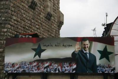 "Assad poster: ""Allah Protects Syria"""