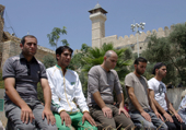 Muslims praying in Hebron