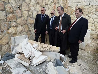 (l. to r.) EVC Malcolm Hoenlein, Rabbi Abraham Lubinsky, and Congressmen Eliot Engel and Jerald Nadler looking at desecrated gravestones.