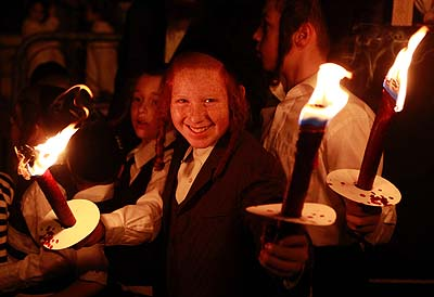 Jewish kids holding torches in Jerusalem on Simchat Torah – now, that's happy!