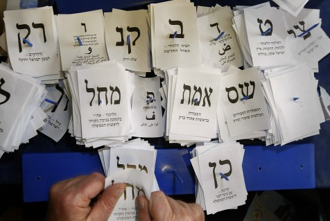 Israeli election workers count remaining ballots from soldiers and absentees at the Knesset in Jerusalem