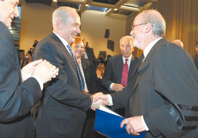 Judge Asher Grunis, new president of Israel&#039;s Supreme Court, is congradulated by Prime Minister Netanyahu at inauguration ceremony on Tuesday.