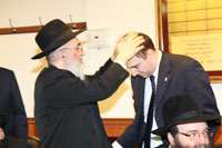 Rabbi Shlomo Chai Niyazov of Congregation L'maan Achai Bukhorim blessing NYS Senate candidate David Storobin.