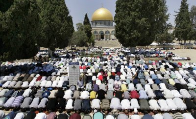 Muslims pray in front of the Dome of the Rock on the compound known to Muslims as al-Haram al-Sharif and to Jews as Temple Mount.