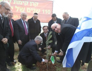 Knesset Speaker Reuven Rivlin planting a tree with the Jewish National Fund, 2012