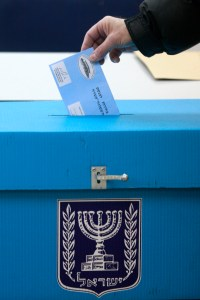 Israeli citizen casting a vote