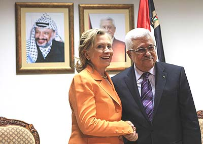 Secretary of State Clinton meets with PA President Mahmoud Abbas in Ramallah, under the watchful eyes of his late predecessor.
