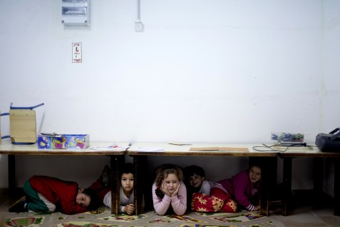 Israeli children take taking cover inside a shelter while a rocket alarm sounds outside, in kibbutz Nir Oz, near the Gaza border. March 12, 2012.