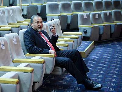 Israel's Foreign Minister Avigdor Liberman seen speaking on his cellphone between meetings.