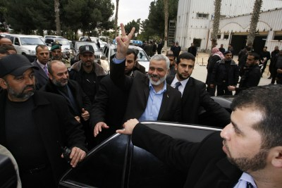 Hamas leader Ismail Haniyeh flashes the victory sign as he returns from a meeting with Egyptian leaders