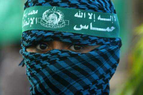 Hamas militant during a rally to mark 23 years  of Hamas, formed at the outset of the 'first intifada'.
