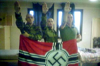 The photograph that got the three neo-Nazis booted from the French Army.