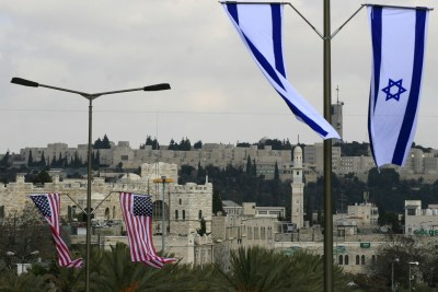 American and Israeli flags are hung up in Jerusalem