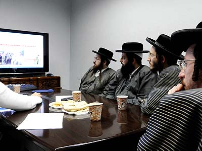 The beginning of the end? Ultra orthodox Jews watching a computer screen, perhaps for the first time in their lives.