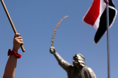 Demonstrators march in support of Bashar al-Assad's regime