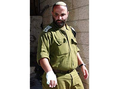 IDF Lieutenant Colonel Shalom Eisner arrives to his home in Jerusalem.
