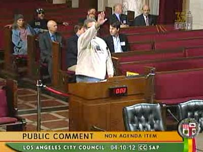 LA resident Michael Carreon doing the Heil thing during an official City Hall meeting..