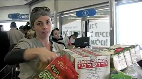 Malkah Fleisher, JewishPress.com writer, at the checkout line after 3 hours in the Jerusalem grocery store preparing for Pesach.