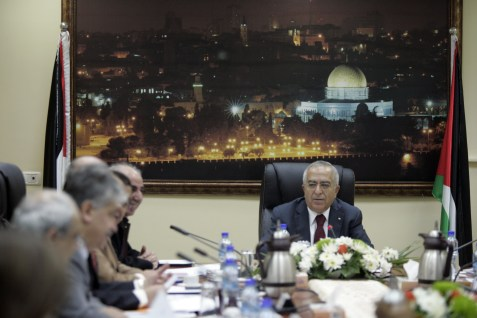 Palestinian Prime Minister Salam Fayyad heads a cabinet meeting in Ramallah