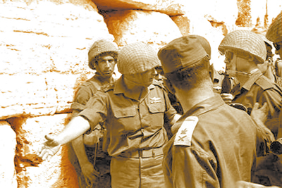 "IDF Chief of Staff Yitzhak Rabin ""invites"" Defense Minister Moshe Dayan to the Kotel, or Western Wall, which had just been liberated by Israeli troops during the 1967 Six-Day War. history."