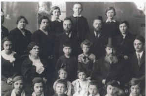 On the far left is the Rebbetzin of R. Yosef Leib. Rav Zalman and Rav Avraham Yitzhak Bloch are clearly seen in the center. Rivkah appears in the front row, second from the right, as a small girl. The gentleman with the top hat is Rabbi Binyamin Denis, Rivkah's maternal grandfather. His rebbetzin is seated to his right. If you can identify other people in the photo, please email us.