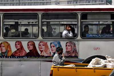 Egyptian men ride a bus in Cairo.